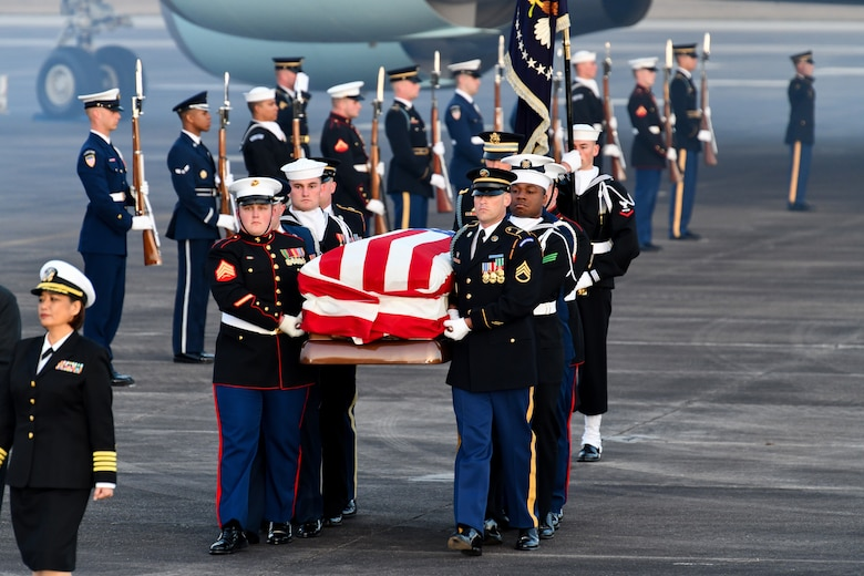 Service members of the joint forces honor guard provide military honors during the arrival of former President George H. W. Bush