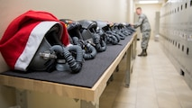Staff Sgt. Clayton Riegle, 2nd Operations Support Squadron aircrew flight equipment NCO in charge, places helmets on a counter at Barksdale Air Force Base, La., Dec. 13, 2018. The 2nd OSS manage and maintain the equipment of over 300 air crew members. (U.S. Air Force photo by Airman 1st Class Lillian Miller)