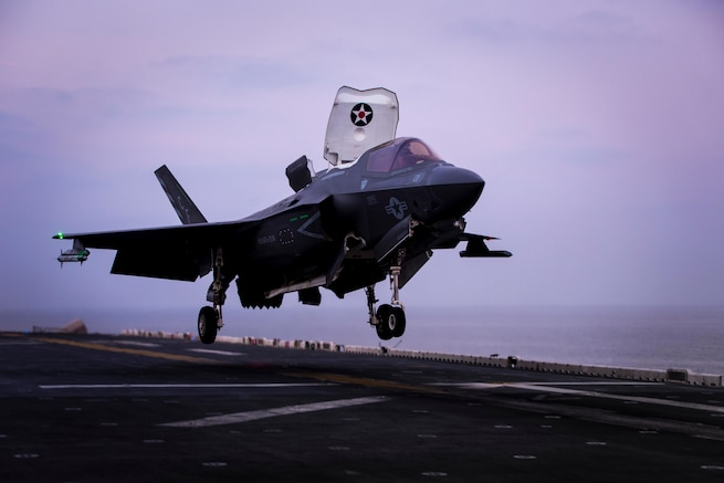 ARABIAN SEA – An F-35B Lightning II assigned to Marine Fighter Attack Squadron 211 (VMFA), 13th Marine Expeditionary Unit (MEU), makes final preparations to land aboard the Wasp-class amphibious assault ship USS Essex (LHD 2), Jan. 9, 2019. The Essex is the flagship for the Essex Amphibious Ready Group and, with the embarked 13th MEU, is deployed to the U.S. 5th Fleet area of operations in support of naval operations to ensure maritime stability and security in the Central Region, connecting the Mediterranean and the Pacific through the western Indian Ocean and three strategic choke points. (U.S. Marine Corps photo by Cpl. A. J. Van Fredenberg/Released)