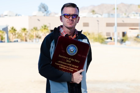 Walter Christianson poses for a photo during an award ceremony at the Victory Field Amphitheater on MCAGCC, Calif., Jan. 10, 2019. Three awards were given for environmental quality, environmental restoration, and natural resources conservation team or individual.   (U.S. Marine Corps photo by Lance Cpl. Colton Brownlee)