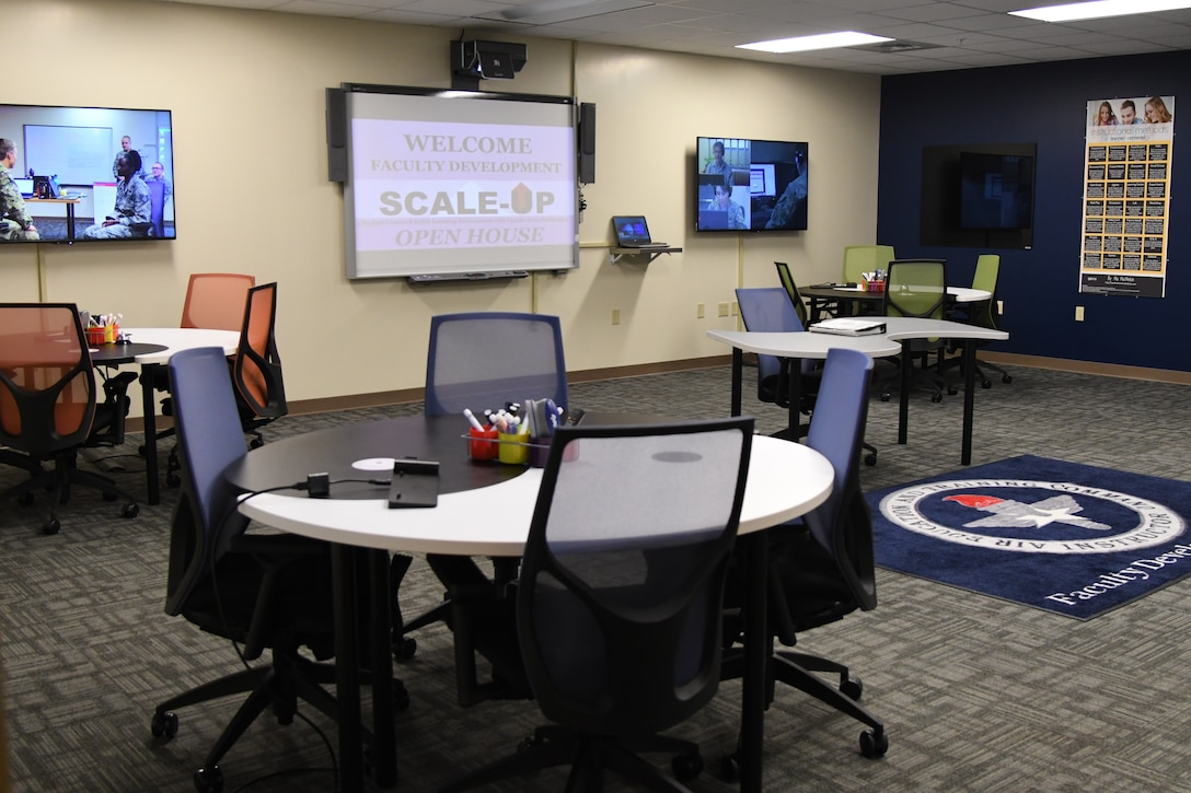 A Student-Centered Active Learning Environment with Upside-down Pedagogies class room is displayed during the SCALE-UP ribbon cutting ceremony inside Allee Hall at Keesler Air Force Base, Mississippi, Jan. 10, 2019. The SCALE-UP program was introduced by the 81st Training Support Squadron as a way to bring new technology and teaching techniques into Keesler classrooms to put more focus on students and their success in Air Force education. (U.S. Air Force photo by Kemberly Groue)