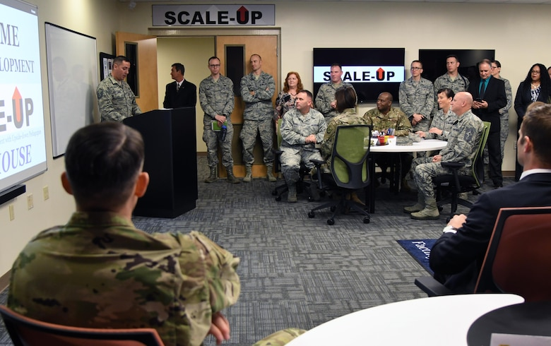 Keesler leadership and 81st Training Wing personnel attend the Student-Centered Active Learning Environment with Upside-down Pedagogies ribbon cutting ceremony inside Allee Hall at Keesler Air Force Base, Mississippi, Jan. 10, 2019. The SCALE-UP program was introduced by the 81st Training Support Squadron as a way to bring new technology and teaching techniques into Keesler classrooms to put more focus on students and their success in Air Force education. (U.S. Air Force photo by Kemberly Groue)
