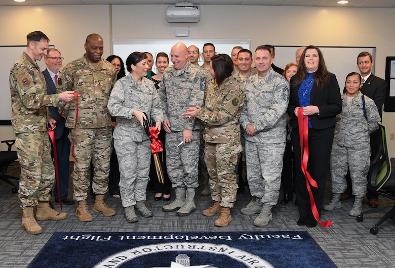 Keesler leadership participates in the Student-Centered Active Learning Environment with Upside-down Pedagogies ribbon cutting ceremony inside Allee Hall at Keesler Air Force Base, Mississippi, Jan. 10, 2019. The SCALE-UP program was introduced by the 81st Training Support Squadron as a way to bring new technology and teaching techniques into Keesler classrooms to put more focus on students and their success in Air Force education. The new program has also brought a new way to teach basic skills like time management and critical thinking to the students while learning their career field. (U.S. Air Force photo by Kemberly Groue)