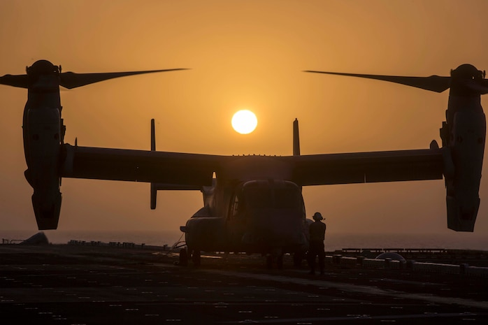 ARABIAN SEA – U.S. Navy Aviation Boatsmate Handler Airmen Bryan Sanchez, assigned with the Essex Amphibious Ready Group (ARG), prepares a U.S. Marine Corps MV-22B Osprey with Marine Medium Tiltrotor Squadron 166 Reinforced, 13th Marine Expeditionary Unit (MEU), for takeoff while aboard the Wasp-class amphibious assault ship USS Essex (LHD 2), Jan. 5, 2019. The Essex is the flagship for the Essex ARG and, with the embarked 13th MEU, is deployed to the U.S. 5th Fleet area of operations in support of naval operations to ensure maritime stability in the Central Region, connecting the Mediterranean and the Pacific through the western Indian Ocean and three strategic choke points. (U.S. Marine Corps photo by Sgt. Francisco J. Diaz Jr./Released)