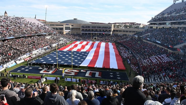 Volunteers unfold the American flag before the Armed Forces Bowl, Dec. 22, 2018, at Fort Worth, Texas. The flag was unfolded during the playing of the national anthem to honor every branch of the U.S. military. (U.S. Air Force photo by Amn Dallin Wrye)