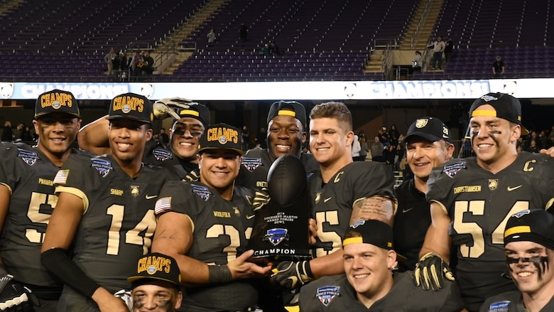 The U.S. Army team poses with the 2018 Armed Forces Bowl championship trophy, Dec. 22, 2018, at Fort Worth, Texas. This game tied for the highest scoring bowl game of all time. (U.S. Air Force photo by Amn Dallin Wrye)