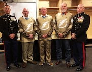 U.S. Marine Corps Colonels Devin Young, left, Marine Corps Forces, Central Command's Staff Judge Advocate and Thomas Pecina, right, MARCENT Chief of Staff, flank Medal of Honor recipients, U.S. Army Sgt. Gary Beikirch, U.S. Army Command Sgt. Maj. Gary Littrell, and U.S. Army Staff Sgt. Drew Dix for a photo during a Tampa Bay Lightning game commemorating the announcement of the 2019 Congressional Medal of Honor Society Convention. The convention will be held in Tampa 22-29 October 2019 and bring together roughly 50 of the 74 surviving Medal of Honor recipients for a week of events in the Tampa Bay area.