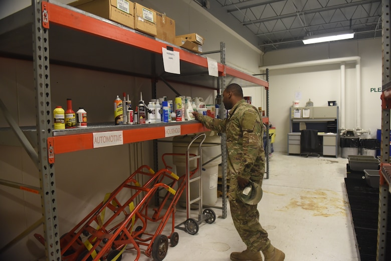 An Airman searches for household cleaning supplies at the Hazmart on Ellsworth Air Force Base, S.D. Professionals from the 28th Logistics Readiness Squadron provide a safe and environmentally-friendly way for Airmen to dispose of their unwanted household chemicals, as well as receive other items for free. Since its opening in January 2018, the Hazmart has issued around 150 individual items and received more than 230 others. (U.S. Air Force photo by Senior Airman Michella Stowers)