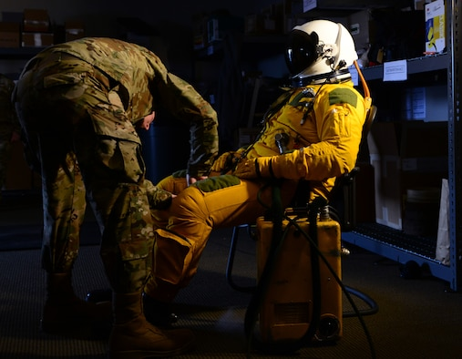 Senior Airman Jonathan Branson, 9th Physiological Support Squadron launch and recovery technician, prepares a U-2 Dragon Lady pilot for a flight