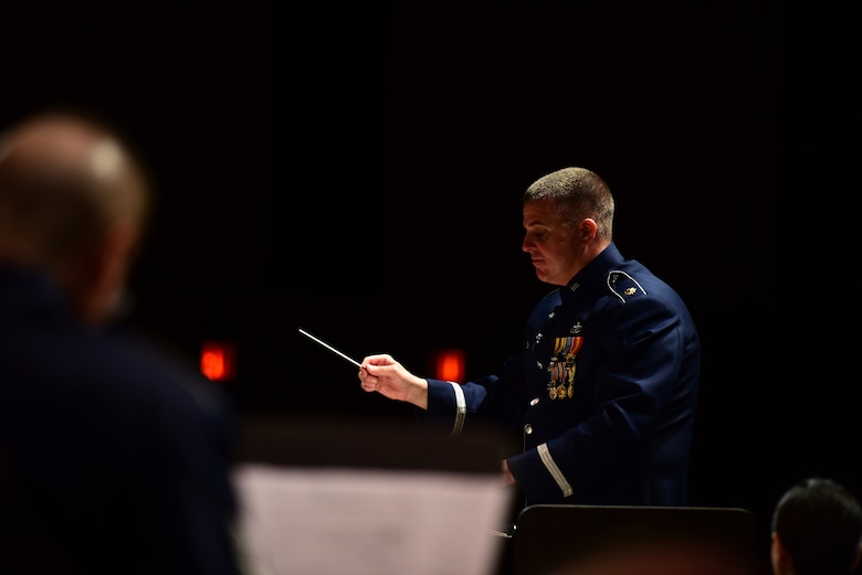 Major Joseph Denti, commander of the Air National Guard of the Northeast, conducts the band during its annual holiday concert December 16, 2018, at the Scottish Rite Cathedral in Harrisburg, Pennsylvania. The concert was free and open to the public and featured a 35-piece wind-ensemble performing several winter and holiday-themed songs. (U.S. Air National Guard photo by Senior Airman Rachel Loftis/Released)