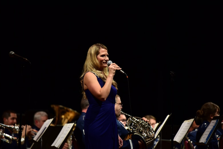 Staff Sgt. Megan May, vocalist with the Air National Guard Band of the Northeast, performs during the band's annual holiday concert December 16, 2018, at the Scottish Rite Cathedral in Harrisburg, Pennsylvania. The concert was free to the public and featured many winter and holiday-themed songs. (U.S. Air National Guard photo by Senior Airman Rachel Loftis/Released)