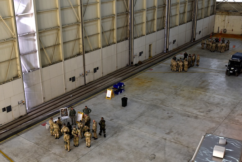 Members of the North Carolina Air National Guard participate in an Ability To Survive and Operate (ATSO) training held in a C-17 Globemaster III hangar at the North Carolina Air National Guard (NCANG) Base, Charlotte Douglas International Airport, Jan. 10, 2019. The ATSO exercise consists of ten rotating stations and serves as refresher training for situations like self-aid buddy care, explosive ordinance device recognition, and chemical warfare decontamination stations.