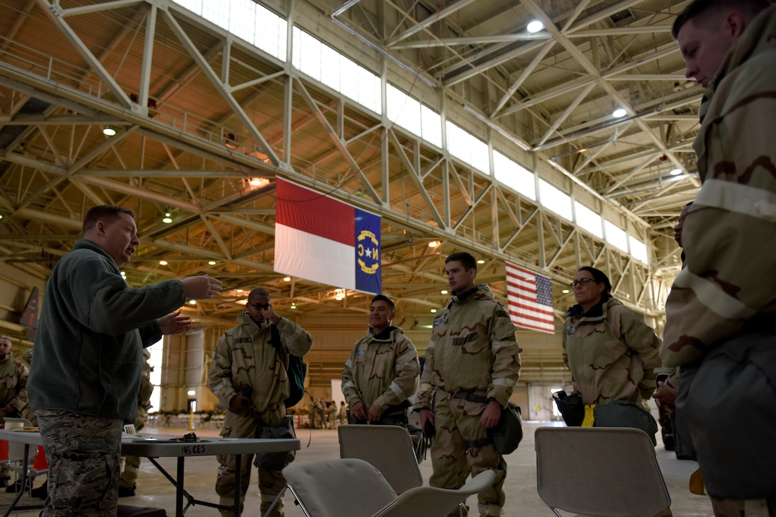 U.S. Air Force Tech. Sgt. Mark Fow, emergency management with the 145th Civil Engineering Squadron, teaches Members of the North Carolina Air National Guard how to read M-9 chemical detection paper during an Ability To Survive and Operate (ATSO) training held in a C-17 Globemaster III hangar at the North Carolina Air National Guard (NCANG) Base, Charlotte Douglas International Airport, Jan. 10, 2019. The ATSO exercise consists of ten rotating stations and serves as refresher training for situations like self-aid buddy care, explosive ordinance device recognition, and chemical warfare decontamination stations.