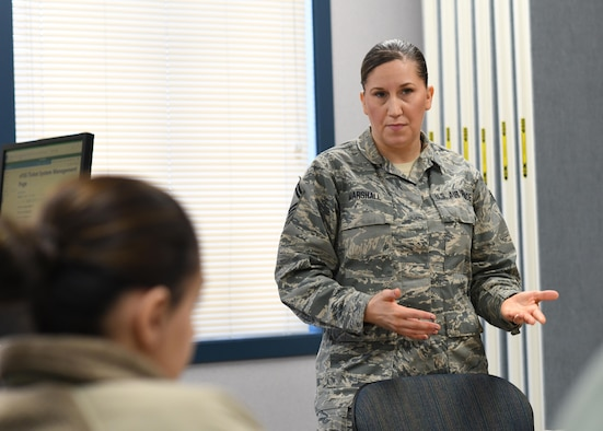 Senior Master Sergeant Shannon Marshall, the super intendent for the 910th military personnel section, explains the virtual Force Support Squadron system to Reserve Citizen Airmen during an open house at the Civil Engineering Building, January 12, here. The purpose of the open house was to educate the wing on a variety personnel programs Airmen frequently have  questions about.