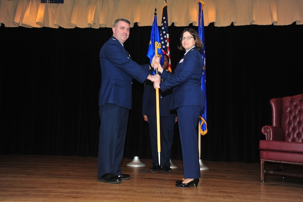 Col. Brian A. May, 403rd Operations Group commander, presents the guidon of the 36th Aeormedical Evacuation Squadron to Lt. Col. Deborah S. Deja as she assumes command during a passing of the flag ceremony held in the Keesler Medical Center at Keesler Air Force Base, Mississippi, January 13, 2019.  (U.S. Air Force photo by Tech. Sgt. Michael Farrar)