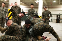Marines with 3rd Marine Logistics Group attempt to use an Antidote Treatment Nerve Agent Autoinjector (ATNAA) on a Marine exposed to a simulated chemical agent Jan. 11, 2019 at Camp Kinser, Okinawa, Japan. For instructional purposes, Marines practiced administering antidotes to simulated combatants affected by chemical, biological, radiological and nuclear (CBRN) agents. The ATNAA was designed to help Marines who have been exposed to CBRN agents. Marines trained in reconnaissance, surveillance and decontamination (RS&D) are required to take a refresher course every fiscal quarter to ensure they are capable of performing RS&D tasks operationally. (U.S. Marine Corps photo by Lance Cpl. Mark Fike)