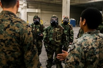 Marines with 3rd Marine Logistics Group practice donning and using protective gear in a chemical, biological, radiological and nuclear (CBRN) environment Jan. 11, 2019 at Camp Kinser, Okinawa, Japan. Marines trained in reconnaissance, surveillance and decontamination (RS&D) are required to take a refresher course every fiscal quarter to ensure they are capable of performing RS&D tasks operationally. (U.S. Marine Corps photo by Lance Cpl. Mark Fike)