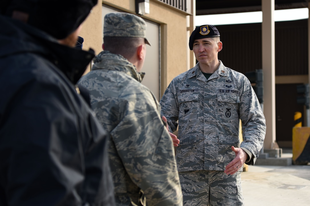 U.S. Air Force Maj. Stephen Addington, 51st Security Forces Squadron commander, gives Team Osan members a tour of the newly improved Morin Gate during its opening ceremony at Osan Air Base, Republic of Korea, Jan. 4, 2019. The project, funded by the ROK, cost $17.8 million and upgraded its capacity to monitor the access of privately owned vehicles, search commercial vehicles, and process visitor and long-term pass requests. (U.S. Air Force photo by Senior Airman Kelsey Tucker)
