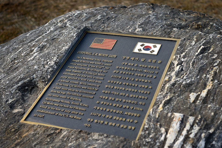 A plaque honors the service of Cpl. Joseph R. Morin, namesake of the newly opened Morin Gate at Osan Air Base, Republic of Korea, Jan. 4, 2019. Morin was the first Air Police member killed in combat action after the establishment of the U.S. Air Force as a separate branch of service. (U.S. Air Force photo by Senior Airman Kelsey Tucker)