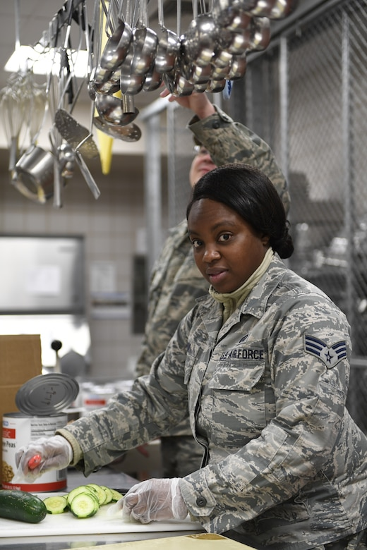 Members from both the North Carolina Air National Guard andNiagara Falls Air Reserve Station, New York, prepare lunch in the dining facility during drill weekend at the North Carolina Air National Guard Base, Charlotte Douglas International Airport, Jan. 12, 2019. Food services Airmen from the North Carolina Air National Guard train members from theNiagara Falls Air Reserve Station, New York, on full-service kitchen operations in preparation for the upcoming Air Force active duty and reserve Hennessy Award competition.