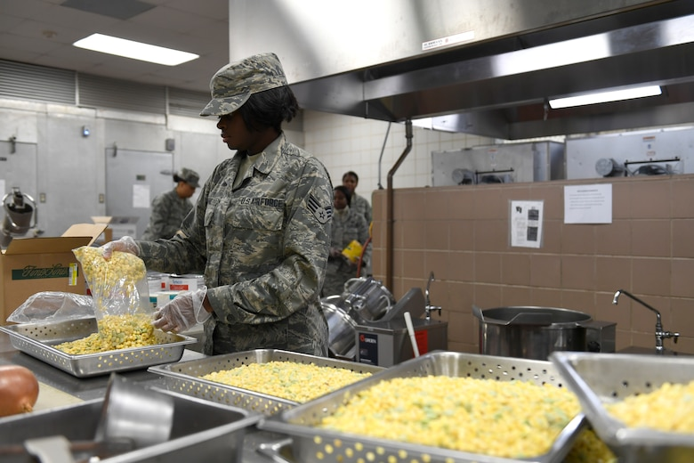 U.S. Air Force Senior Airman Lisa Banks, 145th Force Support Squadron, unpacks corn in preparation for lunch in the dining facility during drill weekend at the North Carolina Air National Guard Base, Charlotte Douglas International Airport, Jan. 12, 2019. Food services Airmen from the North Carolina Air National Guard train members from theNiagara Falls Air Reserve Station, New York, on full-service kitchen operations in preparation for the upcoming Air Force active duty and reserve Hennessy Award competition.