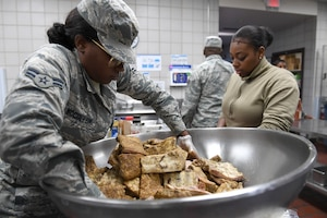 U.S. Air Force Airman 1st Class Pachea McCollum (left), 914th Air Refueling Wing, prepares lunch in the dining facility during drill weekend at the North Carolina Air National Guard Base, Charlotte Douglas International Airport, Jan. 12, 2019. Food services Airmen from the North Carolina Air National Guard train members from the Niagara Falls Air Reserve Station, New York, on full-service kitchen operations in preparation for the upcoming Air Force active duty and reserve Hennessy Award competition.