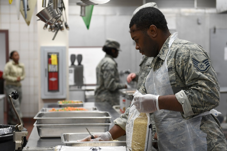 U.S. Air Force Staff Sgt. William Weldon, 145th Force Support Squadron, prepares rice for lunch in the dining facility during drill weekend at the North Carolina Air National Guard Base, Charlotte Douglas International Airport, Jan. 12, 2019. Food services Airmen from the North Carolina Air National Guard train members from theNiagara Falls Air Reserve Station, New York, on full-service kitchen operations in preparation for the upcoming Air Force active duty and reserve Hennessy Award competition.