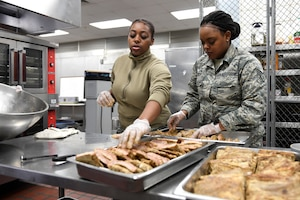 Members from both the North Carolina Air National Guard and Niagara Falls Air Reserve Station, New York, prepare lunch in the dining facility during drill weekend at the North Carolina Air National Guard Base, Charlotte Douglas International Airport, Jan. 12, 2019. Food services Airmen from the North Carolina Air National Guard train members from the Niagara Falls Air Reserve Station, New York, on full-service kitchen operations in preparation for the upcoming Air Force active duty and reserve Hennessy Award competition.