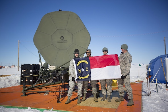 U.S. Air Force Staff Sgt. Kristofer Vandermark, far left; Staff Sgt. Titus Poulose, left; Staff Sgt. Michael Jennings, right; and Master Sgt. Chris Farnsworth, far right, of the 263rd Combat Communications Squadron, a detachment of the 145th Airlift Wing, pose for a photo while deployed to Antarctica in support of Operation Deep Freeze (ODF), at McMurdo Station, Antarctica, Dec. 1, 2018. ODF is a military mission in support of the National Science Foundation throughout the continent of Antarctica, to provide air, land, and sea support to McMurdo Station.