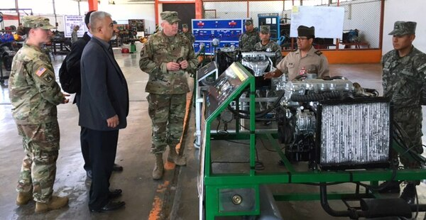 Combined Arms Support Command and Army South members receive a tour of Peruvian Army maintenance facilities on a recent visit to Peru. Six CASCOM and ARSOUTH members visited the Peruvian Army to assist in modernizing their logistics doctrine and programs to better support future operational requirements.