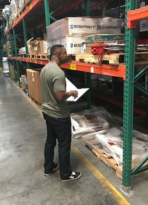 Army 1st Lt. Jason Bryant, currently interning with DLA Disposition Services, assists with an inventory at the Pearl Harbor, Hawaii, site.