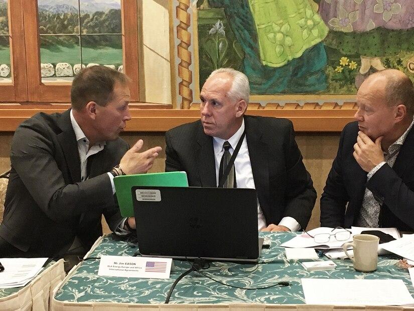 DLA Energy International Agreements Specialist Jim Eason confers with Spanish fuel representatives during the 2018 Fuel Exchange Agreement Forum in Garmisch-Partenkirchen, Germany.
