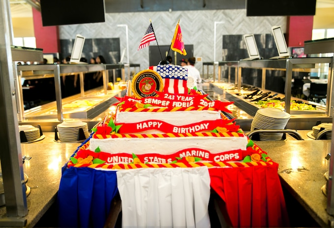 Marines and Sodexo employees prepare a traditional birthday cake for the Marine Corps' 243rd birthday lunch at Littleton Mess Hall, aboard Marine Corps Air Ground Combat Center, Twentynine Palms, Calif., Nov. 9, 2018. Sodexo works for the Marine Corps every year to provide a birthday meal for the Marines at the mess halls across the installation. (Marine Corps photo by Cpl. Ashlee Conover)