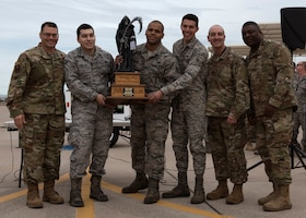 The 310th Aircraft Maintenance Unit load crew team accepts a trophy after the 56th Fighter Wing Quarterly Load Crew Competition at Luke Air Force Base, Ariz., Jan. 10, 2019.