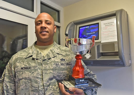 U.S. Air Force Master Sgt. Christopher R. Monroe, 100th Civil Engineer Squadron facilities operations superintendent, stands with his Innovation of the Quarter Award at RAF Mildenhall, England, Jan. 12, 2019. Monroe won the award for his idea to use dorm e-cards to replace the conventional key and lock on the doors. His idea also included a kiosk that issues temporary e-cards to Airmen who lose, break or misplace their e-card, reducing the expense and time spent on replacing dorm room keys, and allowing the old door locks to be salvaged and used elsewhere on base. (U.S. Air Force photo by Senior Airman Luke Milano)