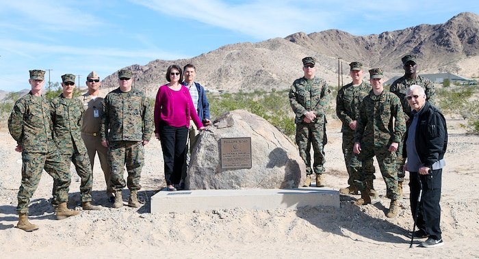Marine Corps Air Ground Combat Center Marines and sailors pose with Melonia Phillips Anderson, her husband, Randy Anderson, and retired Marine Col. Billy D. Bouldin during the trio's Nov. 16, 2018, tour of the base and the memorial monument to Melonia Anderson's brother, Seabee Victor B. Phillips, who was killed in a construction accident Aug. 31, 1976, while helping building the road between Mainside and the new airfield at Camp Wilson. Bouldin was chief of staff in 1976, and oversaw construction of the airfield and roadway. (Marine Corps photo by Kelly O'Sullivan)