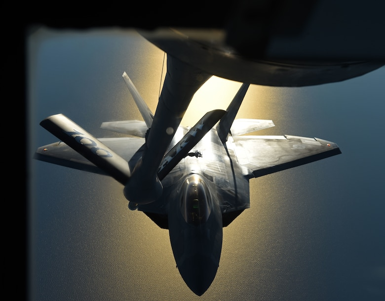 An F-22 Raptor flies behind a KC-135 Stratotanker during aerial refueling training off the coast of Finland, Oct 19, 2018.