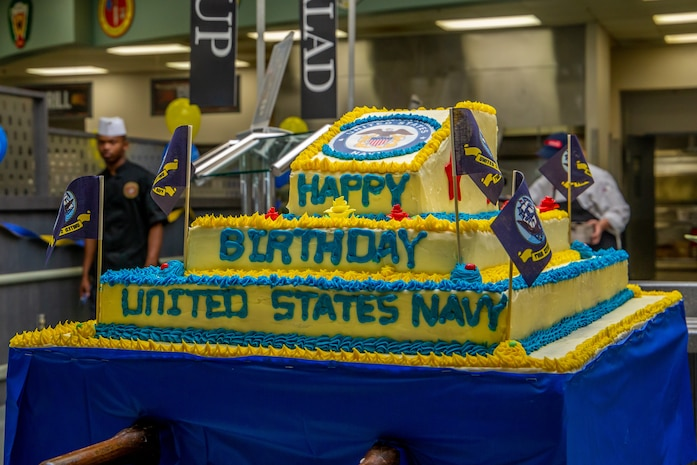 The U.S. Navy celebrates its 243rd birthday with a cake at Phelps Chow Hall, aboard Marine Corps Air Ground Combat Center, Twentynine Palms, Calif., Oct. 11, 2018. The local chow halls aboard the Combat Center also provided steak and lobster entrees to all personnel to honor the birthday. Founded on Oct. 13, 1775, the Continental Navy was created by Congress to defend and protect American coastal communities and colonies from British attacks, and to disrupt British communications. (U.S. Marine Corps photo by Lance Cpl. Rachel K. Young)
