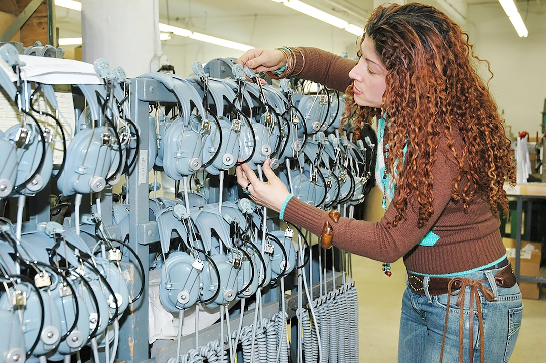 An employee prepares finished aviation headsets before shipment at the Roanwell manufacturing facility in the Bronx, New York.