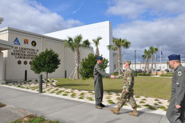 Photo of Lt. Col. Andrew Congdon, 513th Electronic Warfare Squadron commander, greets Air Force Vice Chief of Staff Gen. Stephen W. Wilson