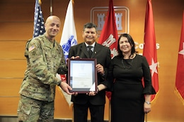 USACE Deputy Commanding General for Civil and Emergency Operations Maj. Gen. Scott Spellmon inducted South Pacific Division Regional Business Director John Moreno into the Senior Executive Service at a ceremony in the Los Angeles District Jan. 10. Moreno's wife Joann, grandson Edward Lopez, and nephew Jonathan Ochoa participated in the presentation of the induction pin, reciting of the oath of office, and uncasing and unfurling of the flag of the Senior Executive Service. Moreno has more than 26 years of experience with the Corps and now provides executive leadership and direction for the South Pacific Division and its four subordinate Districts in operating as a Regional Business Center.