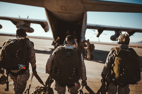 U.S. Marines with 3rd Reconnaissance Battalion, 3rd Marine Division, III Marine Expeditionary Force, walk towards a  AC-130 at Marine Corps Air Ground Combat Center, Twentynine Palms, Calif., Oct. 25, 2018, as a part of Integrated Training Exercise 1-19. The purpose of ITX is to create a challenging, realistic training environment that produces combat-ready forces capable of operating as an integrated Marine Air Ground Task Force. (U.S. Marine Corps Photo by Sgt. Joshua Elijah Chacon)