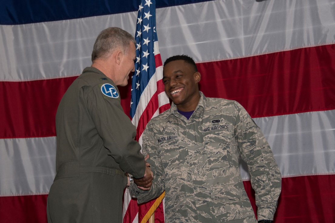 U.S. Air Force Col. Robert VanHoy, 307th Bomb Wing commander, and Chief Master Sgt. Darren Demel, 307th BW command chief, recognized three Community College of the Air Force graduates during a commander's call at Barksdale Air Force Base, Louisiana, Jan. 13, 2019.  Those receiving degrees are Tech. Sgt. John Hanks, Staff Sgt. William Monteagudo, and Staff Sgt. Trevor Talbert. (U.S. Air Force photo by Airman 1st Class Maxwell Daigle)