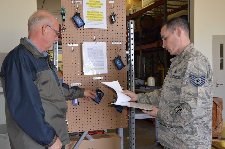 Tech. Sgt. Mark Melchionda (right), 709th Support Squadron section chief of transportation, discusses vehicle dispatch operations with his boss, James Battenfelder, 709th SPTS transportation manager.  The squadron recently streamlined its transportation and shipping operations to more efficiently manage its fleet of vehicles and cargo shipments.