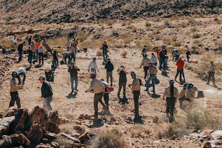 Volunteers begin construction on a water guzzler at Marine Corps Air Ground Combat Center, Twentynine Palms, Calif., Jan. 4, 2019. Members of the San Bernadino County community joined together with the California Conservation Corps to build a water guzzler in an effort to provide natural resources needed to sustain the bighorn sheep population in the surrounding area. (U.S. Marine Corps photo by Lance Cpl. Aaron Harshaw)
