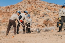 Members of the California Conservation Corps participate in the construction of a water guzzler at Marine Corps Air Ground Combat Center, Twentynine Palms, Calif., Jan 4. 2019. Members of the San Bernadino County community joined together with the California Conservation Corps to build a water guzzler in an effort to provide natural resources needed to sustain the bighorn sheep population in the surrounding area. (U.S. Marine Corps photo by Lance Cpl. Aaron Harshaw)