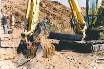 Volunteers utilize heavy equipment during the construction of a water guzzler at the Marine Corps Air Ground Combat Center, Twentynine Palms, Calif., Jan 4. 2019. Members of the San Bernadino County community joined together with the California Conservation Corps to build a water guzzler in an effort to provide natural resources needed to sustain the bighorn sheep population in the surrounding area. (U.S. Marine Corps photo by Lance Cpl. Aaron Harshaw)