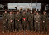 U.S. Marine Corps Chief Warrant Officer Matthew Kessinger, personnel officer of 6th Marine Corps District, poses for a photo with the 6th MCD personnel section after his promotion to chief warrant officer five aboard Marine Corps Recruit Depot Parris Island, South Carolina, Dec. 19, 2018. Kessinger, a native of Louisville, Kentucky, has currently served 28 years in the Marine Corps. (U.S. Marine Corps photo by Lance Cpl. Jack A. E. Rigsby)