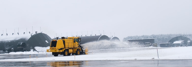 Members with the 35th Civil Engineer Squadron clear snow off the flight line at Misawa Air Base, Japan, Dec. 12, 2018. The 35th CES clears the flight line to create a safe environment for F-16s to takeoff and maintain wing readiness. (U.S. Air Force photo by 1st Lt. Jeremy Garcia)