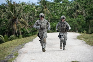 Two students run during the Shoot, Move and Communicate portion of Commando Warrior training at North West Field near Andersen Air Force Base, Guam Dec. 10, 2018. The 736th Security Forces Squadron trains frontline defenders from all bases assigned to Pacific Air Forces on U. S. Central Command and regional training requirements so they can deploy as well as utilize trained skills at their home stations. (U.S. Air Force photo by Master Sgt. JT May III)